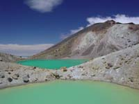 this is a picture of the emerald lakes that can be found when descending from the saddle between mount Tongariro and mount Ngauruhoe, the sight from up on the saddle looking towards mount Ruapehu in the back is unforgettable and truly one of the great sights that make a trip to New Zealand so worthwhile