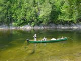 these guys are flyfishing for salmon and sea trouts from a canoe on the cascapedia river in the baie des chaleurs area of Gaspe peninsula in eastern Quebec